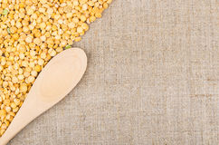 Background from burlap with shelled dried yellow peas Royalty Free Stock Images