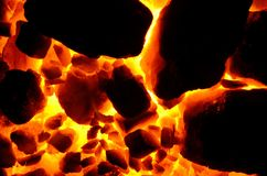 Background of burning and flaring pieces of coal anthracite of different fractions. Stock Image