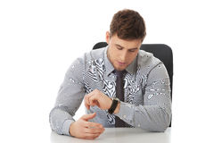background businessman checking his isolated time watch white Στοκ Εικόνες