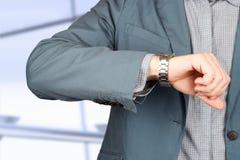 background businessman checking his isolated time watch white Στοκ Φωτογραφίες