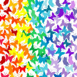 Background with butterflies in rainbow colors Stock Images