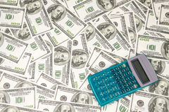 Background of calculator and hundreds dollars Royalty Free Stock Image