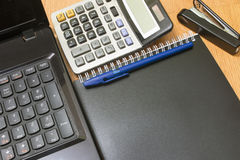 Background calculator and notebook on a desk. Stapler stock photos