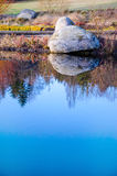 Background of calm water and stone in the evening Stock Photo