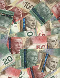 Background of Canadian bills. Portrait orientation background of new Canadian twenty, fifty and hundred dollar bills Royalty Free Stock Photo