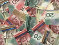 Background of Canadian bills. Background of new Canadian twenty, fifty and hundred dollar bills Royalty Free Stock Photography