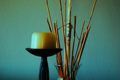 A background of a candle and vase stock images