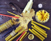 Background with candles and pentagram. Background with assorted candles, quill and paper with pentagram, top view. Black magic ritual. Scary still life with royalty free stock photos