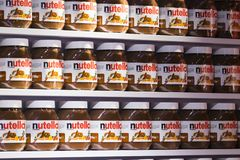 Background with cans of chocolate nutty pasta Nutella attractions of the city Market Sarona . TEL AVIV, ISRAEL - 26 NOVEMBER 2017: Background with cans of royalty free stock photography