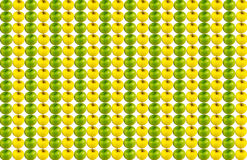 Background canvas vertical row of juicy green apple series of yellow fruits repeated without stopping Stock Photo