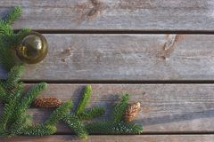 Background for a card for new year and christmas, Christmas tree with a ball on a wooden background.  Royalty Free Stock Images