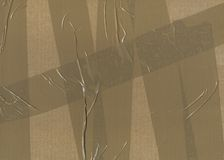 Background cardboard. Surface of cardboard with packaging tape. Unique background Royalty Free Stock Images