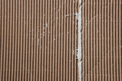 Background of cardboard texture with white plaster Royalty Free Stock Image