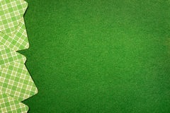 Background with cards on green felt casino table Royalty Free Stock Image