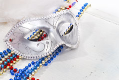 Background with Carnival Mask and beads. Background with Carnival silver Mask and color beads Royalty Free Stock Images