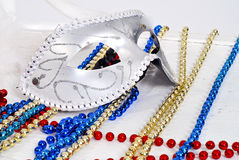 Background with Carnival silver Mask and beads. Background with Carnival silver Mask and color beads Stock Image