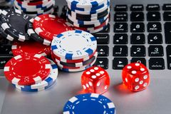 Background for the casino online, on the computer lie the dice royalty free stock image