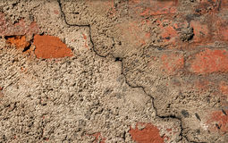 Background of the cement wall grey plain textured with a crack diagonally with elements of red brick. Stock Image