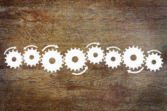 Background with a central bar made of cogwheels Stock Image