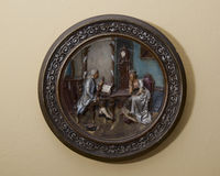 Background. Ceramic decorative plate hanging on the wall Royalty Free Stock Images