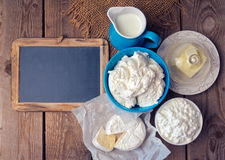 Background with chalkboard, milk and cottage cheese. View from above Stock Image
