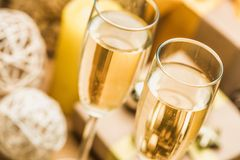 Champagne Glasses with Christmas Decorations and. Background champagne glasses bar color festive party Stock Image