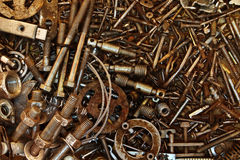 Background from chaotically scattered old bolts Royalty Free Stock Image