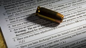 Paperwork for a gun sale Royalty Free Stock Photography