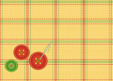 Background of the checkered fabric with buttons. Textile background with a needle and prishitymi buttons Royalty Free Stock Photos