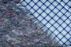 Background of checkered fabric lying on a piece of quilted felt Royalty Free Stock Photos