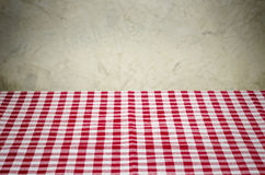 Background with checkered tablecloth and a rustic wall Royalty Free Stock Images