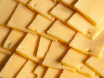 Background of cheese. Background made of sliced cheese Stock Image