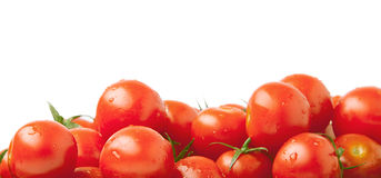 Background from cherry tomatoes. The background from cherry tomatoes is isolated on a white background Stock Photo