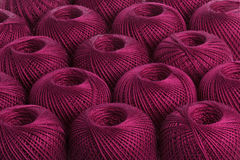 Background cherry yarn. Texture of colored yarn skeins royalty free stock images