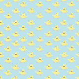 Background of the Chick. Pattern composed of repeating small yellow Chicks on a blue background Royalty Free Stock Photo