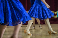 Background - children`s tournament on ballroom dances - feet on the floor Royalty Free Stock Photos