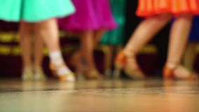 Background - children`s tournament on ballroom dances - feet on the floor stock video footage