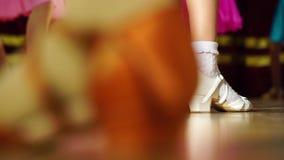 Background - children`s tournament on ballroom dances - feet on the floor stock video