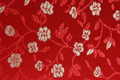 Background China. You see a detail shot from material with texture.Beautiful red with white flowers. China style Stock Photos