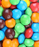 Background of chocolate balls in colorful glaze. Stock Photography