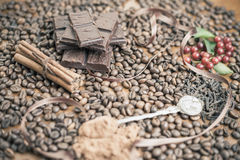 Background of chocolate bar, coffee, hazelnuts, for holiday Stock Photos