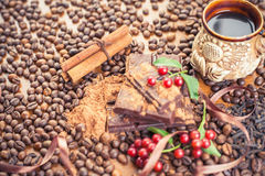 Background of chocolate bar, cup of coffee, hazelnuts, for holiday Royalty Free Stock Images