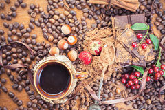 Background of chocolate bar, cup of coffee, hazelnuts, for holiday Stock Photos