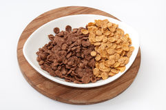 Background of chocolate and gold cornflakes Royalty Free Stock Photos