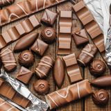 Background of chocolates, bars and sweets, free space for text Stock Image