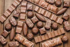 Background of chocolates, bars and sweets, free space for text Stock Photography