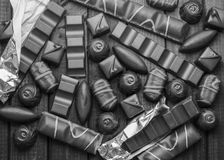 Background of chocolates, bars and sweets, free space for text, black&white Stock Photography