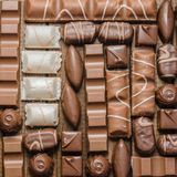 Background of chocolates, bars and sweets, free space for text Stock Photos