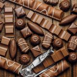 Background of chocolates, bars and sweets, free space for text Royalty Free Stock Image