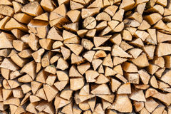 Background of chopped firewood stacked up on top of each other Stock Photo